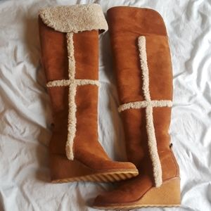 Tory Burch suede shearling over the knee boots.